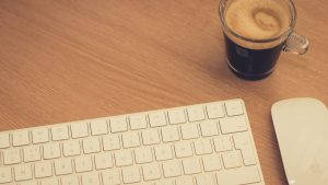 Keyboard and Coffee - The Covey Agency
